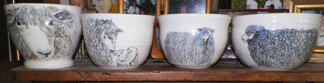 Hand drawn, hand painted Leicester pottery yarn bowls for sale from The Lavender Fleece Farm and Studio in Midland, Michigan. This photo shows how the images come out after the glaze firing. The clay that is used is lustrous grolleg porcelain.