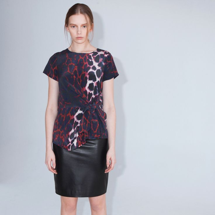 Nocturne is a sophisticated short-sleeved top with a flattering knot at hip.