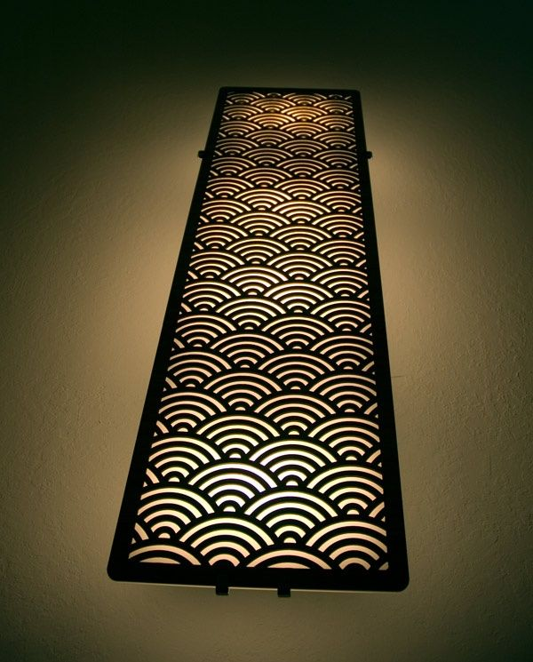 laser cut light fixture. Add some pizzaz to that boring hallway with awesome laser cut sconces.