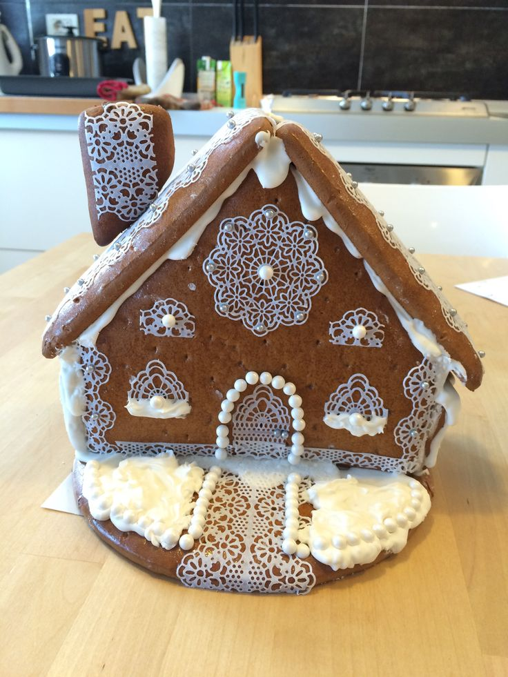 Gingerbread house decorated with sugar lace and pearls