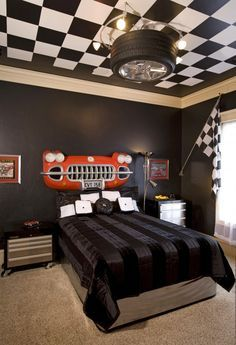 paint the ceiling, checkered, maybe black and orange instead of black and white. tire chandelier, car grille headboard for the bed