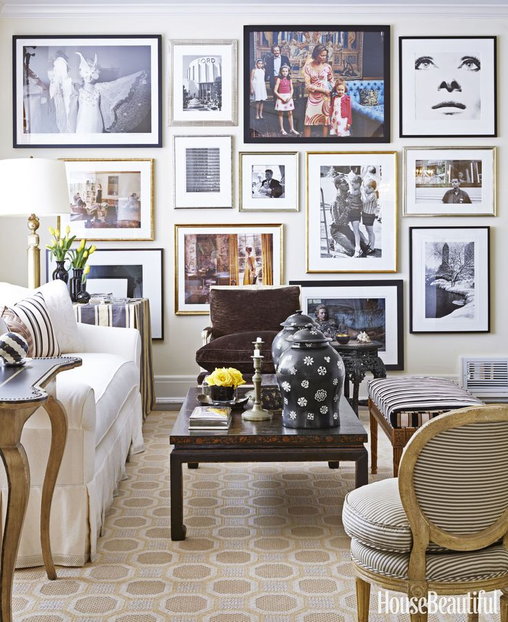 A Gallery Wall In The Living Room Showcases Photography Collection
