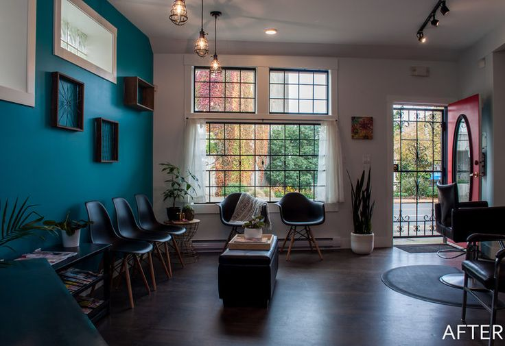 Hair salon waiting area. Bold teal accent wall and black Eiffel chairs.