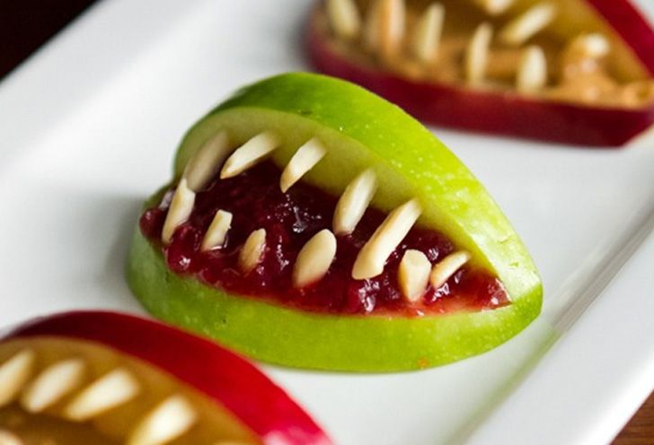 Halloween Apple Bites! Fill sliced apples with red jam, and others with peanut butter or almond butter... and use almond pieces for CrEePy teeth! Yikes!! #MyVeganJournal: Halloween Parties, Idea, Recipe, 3 Ingredients Halloween, Food, Apples Bites, Holidays, Halloween Apples, Healthy Halloween Treats