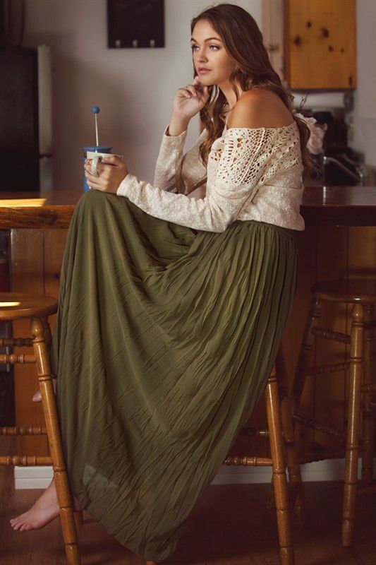 Solid broomsticked maxi skirt. Elasticized waistband. Partially see through just…