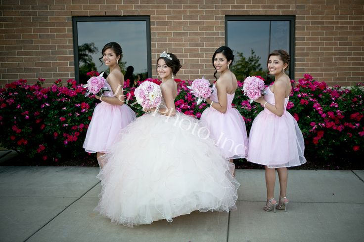 Quinceanera And Damas Facing Sideways For A Photo