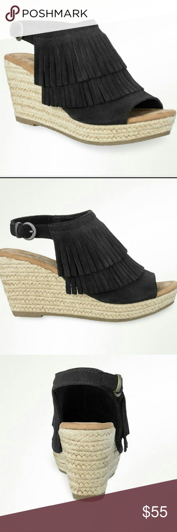 "Minnetonka ""Ashley "" suede wedges These three and a half inch jute wrapped wedges topped with two layers of soft suede fringe & buckled ankle straps offer the perfect mix of fashion and function!  Ideal for daily strolls or heading to a weekend festival, these sandals pair well with everything from denim to a flowey sundress.  Fashion and fun, minnetonka style reaches new heights!  Featuring sassy fringe detailing. BRAND NEW NEVER WORN Minnetonka Shoes Sandals"