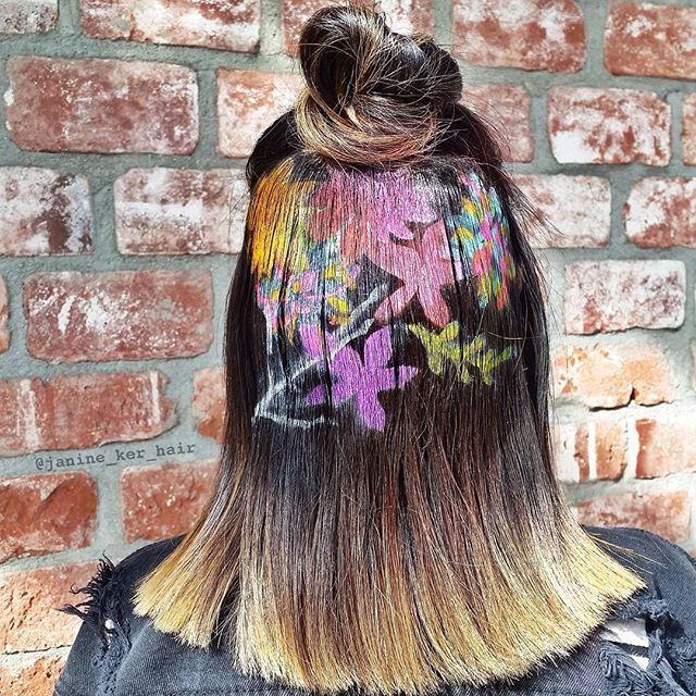 The new hair stencilling trend was made popular by hair genius Janine Ker at Salon Aguayo. It's a new dyeing technique involving the use of stencils and dye to create painted artworks right on top of the hair.
