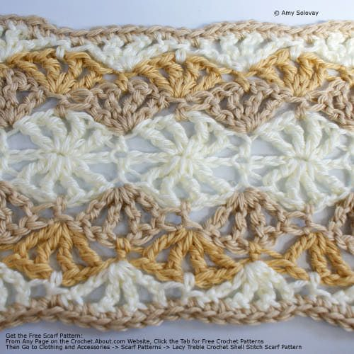Beige and White Scarf made with lacy treble crochet shell stitches. Detailed instructions given.