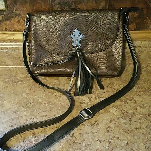 Brown Miss Me purse Brown snake skin Miss Me purse (cross body) from buckle. Only used a few times and in excellent condition! Miss Me Bags Crossbody Bags