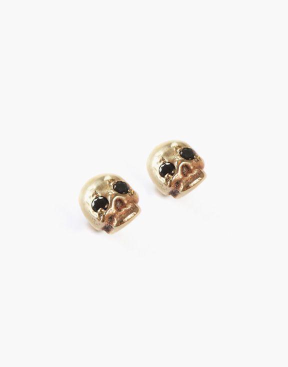 Boucles d'oreilles Memento Mori en or et diamants noirs Atelier L.A.F 448.00 $  Ces boucles d'oreilles en forme de crâne sont inspirées du courant artistique Memento Mori. Faites en en or jaune 10K et serties de diamants noirs, elles ajouteront une touche rock glamour à vos looks.  Dimensions : 5mm x 4mm  Les bijoux sont conçus et créés à Montréal, Canada.  Découvrez d'autres produits de l'Atelier L.A.F