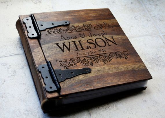Custom handmade wooden wedding album/ photo album with Monogram or personalized engraving This handmade wooden wedding album is crafted to order from hand cut, sanded, and stained wooden sheets. Each piece of wood is carefully and artistically stained using a layering technique to
