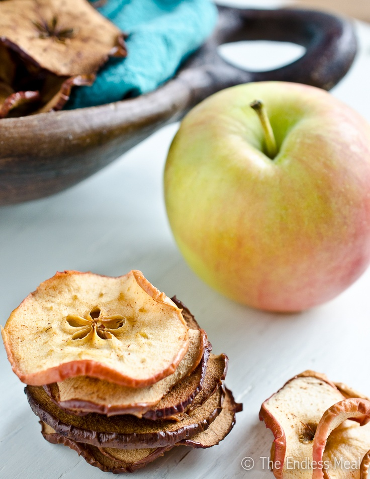 Baked Apple Chips by The Endless Meal--just apple slices with lemon juice and cinnamon, how healthy is that!