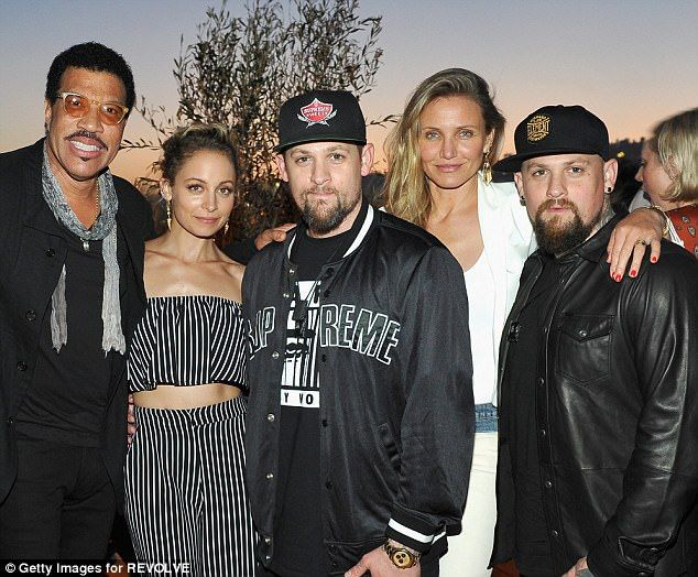 Famous family: Nicole is the daughter of Lionel Richie (L). Her husband Joel is the twin brother of Good Charlotte rocker Benji (R) who is married to Cameron Diaz (2R)