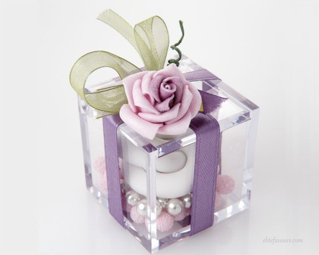High quality Plexiglas small box with two different varieties of Jordan Almonds, including pair of sugar confetti rings, silk ribbon, hand-made flower composition.