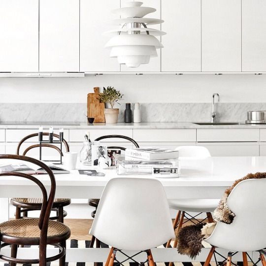 A cosy all white kitchen comes alive with the addition of Herringbone flooring, a mismatch of Thonet Vienna and Eames DSW chairs and the finishing touch a Louis Poulsen Snowball pendant light… what's not to love