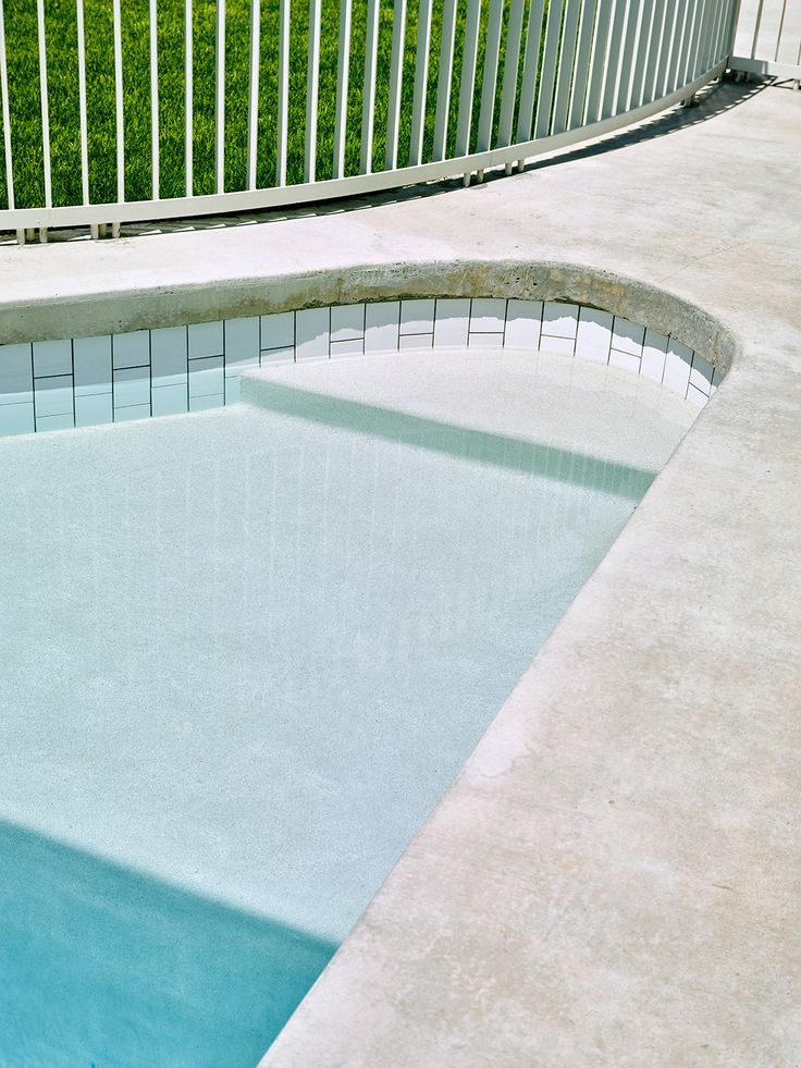 Curved Pool Edge in concrete and white tiles | Rosalie House by Owen Architecture