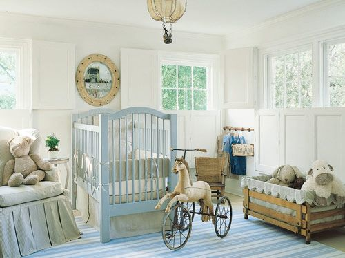 Custom chair and crib bumper in Jane Shelton ticking. Other bedding in linen by Ralph Lauren. Mirror, French horse tricycle and Orkney child's chair, all antiques. Vintage French hot-air balloon light fixture. Custom cotton dhurrie.   - Veranda.com