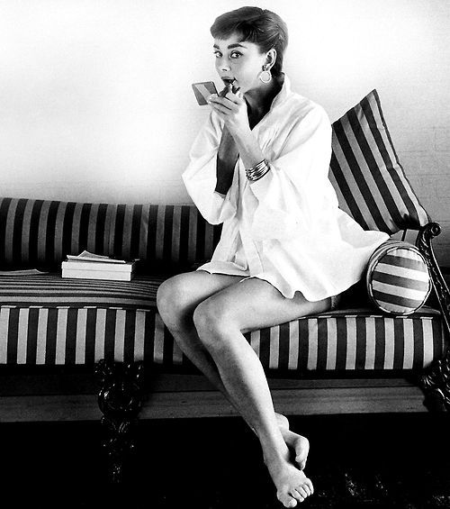 """""""A girl can't read without her lipstick."""" -Audrey Hepburn as Holly Golightly in Breakfast at Tiffany's"""