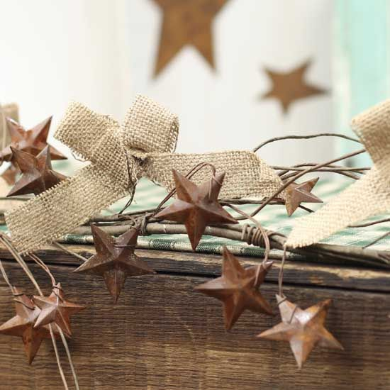 Rustic Garland With Burlap Bows And Rusty Tin Stars Would Love For Above Cabinets