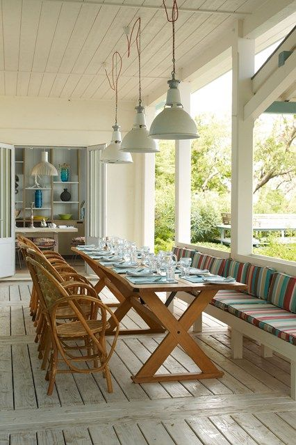 What is it about garden rooms that is so universally appealing? We're getting excited just thinking about the prospect of a seclude little spot somewhere, like this veranda in Cap Ferret