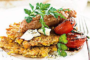 Golden kumara & corn fritters with balsamic tomatoes and breakfast sausages recipe, NZ Woman's Weekly – Try the crunchy fritters with smoked salmon, avocado, and a drizzle of aioli. – foodhub.co.nz