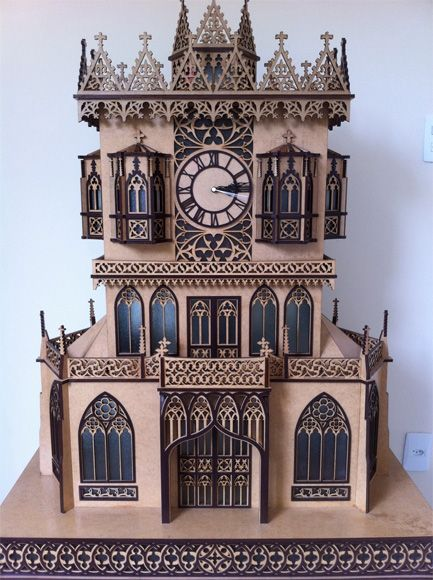 The Bielefeld scroll saw fretwork clock, with amber stained glass and lights, illumination