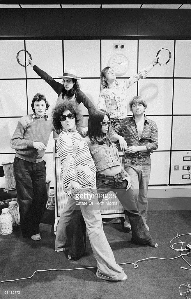 American singer Gloria Jones, British singer Marc Bolan (1947 - 1977), and drummers Davey Lutton and Mickey Finn pose at Scorpio Studios in London, during the recording of a T. Rex song, 1974.