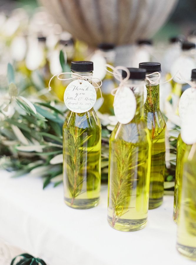 DIY bottled olive oil favors: http://www.stylemepretty.com/2016/02/16/english-garden-style-wedding-in-california/ | Photography: Michele Beckwith - http://michelebeckwith.com/