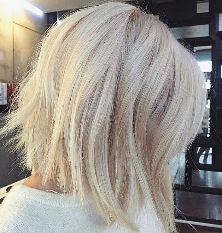 """Wow! Progressive cut and stunning color! @voguehair #behindthechair #platinum"""