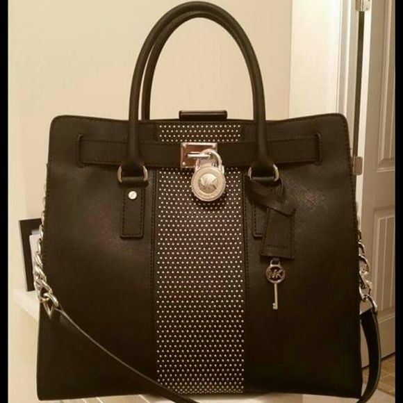 Authentic Michael Kors Bag. Practically New Authentic Hamilton Michael Kors Bag, leather purchased from Macy's, excellent condition. Only used a few times. Has been kept in dust bag. Also have matching wallet in closet. Will sell as set. No LOW BALLERS or TRADES. Saving to buy LV bag. PRICE FIRM Michael Kors Bags