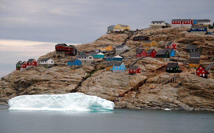 Colorful houses on stilts in Uummannaq, North Greenland