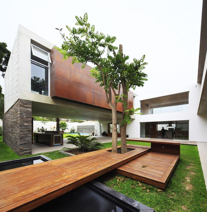 Concrete and Caramel Colored Wood: La Planicie House II by Oscar Gonzalez Moix