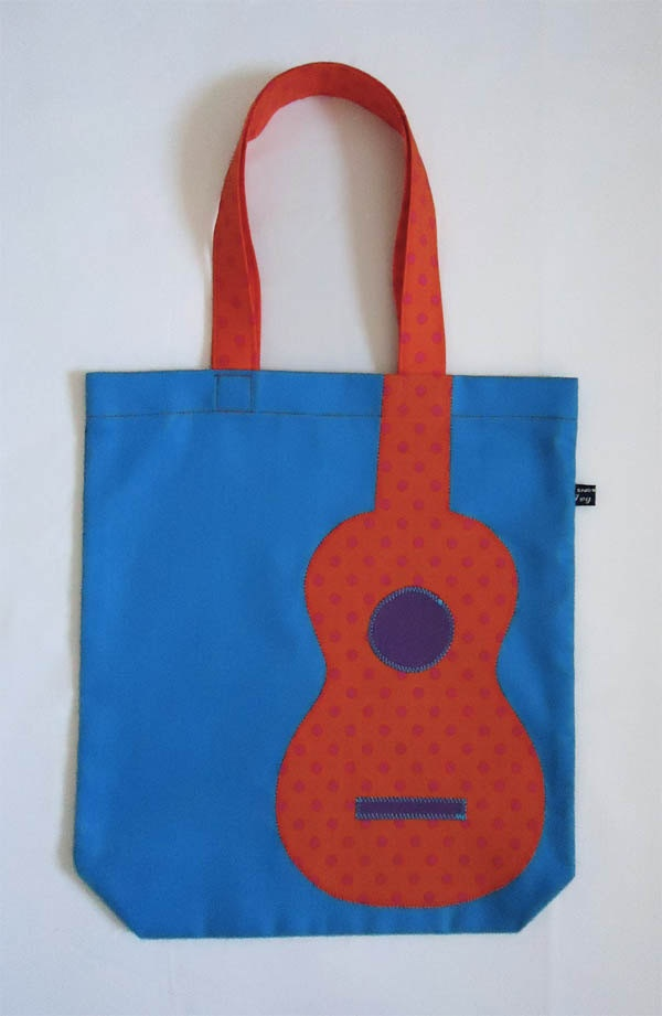 Ukulele appliqué bag in bright blue with orange polka-dot uke by Ivy Arch