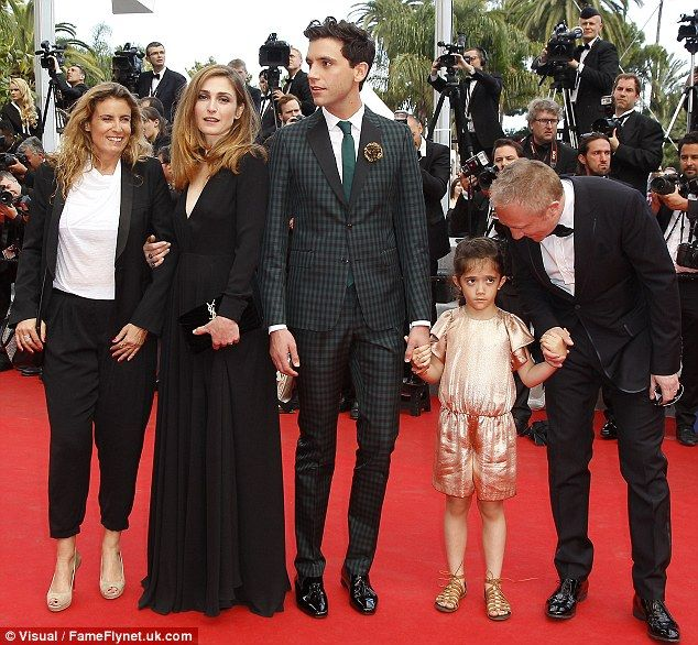 Love the suit!~ Julie Gayet joined by MiKA, Francois-Henri Pinault and his daughter Valentina, as well as director Lisa Azuelos for the Cannes gala screening