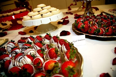 Winter desserts:  chocolate-dipped strawberries, iced sugar cookies, and mini cupcakes (red velvet and chocolate)