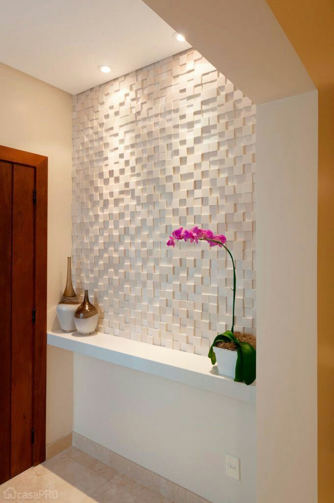 Textured wall in small entryway.