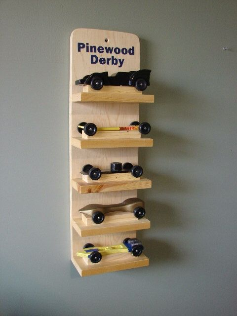 A personal favorite from my Etsy shop https://www.etsy.com/listing/220248360/scout-pinewood-derby-car-display-shelf