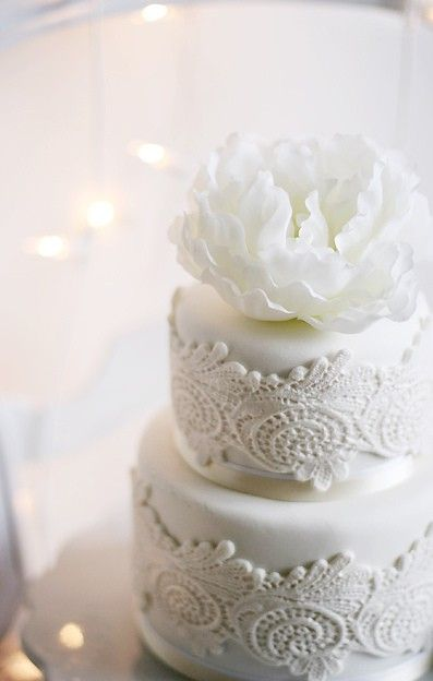 Modern white lace-inspired cake adds the perfect touch to a lace-inspired wedding.