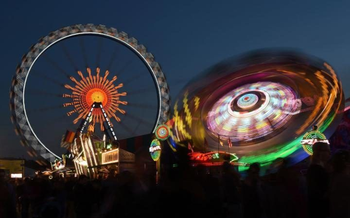 The ferris wheel spins at the Theresienwiese Oktoberfest fair grounds in Munich, southern Germany.