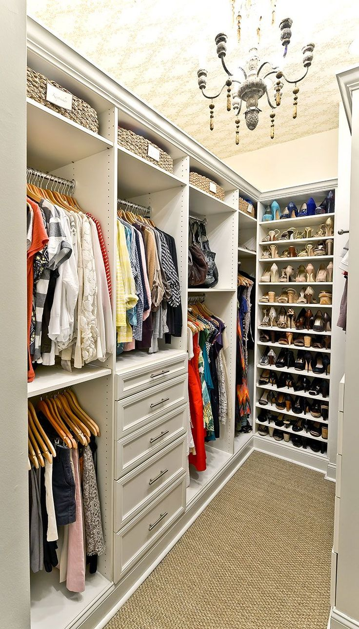 beautiful closet features wallpapered ceiling punctuated with candle chandelier over wall to wall jute carpeting walk in closet with entire cabinet - Custom Closet Design Ideas