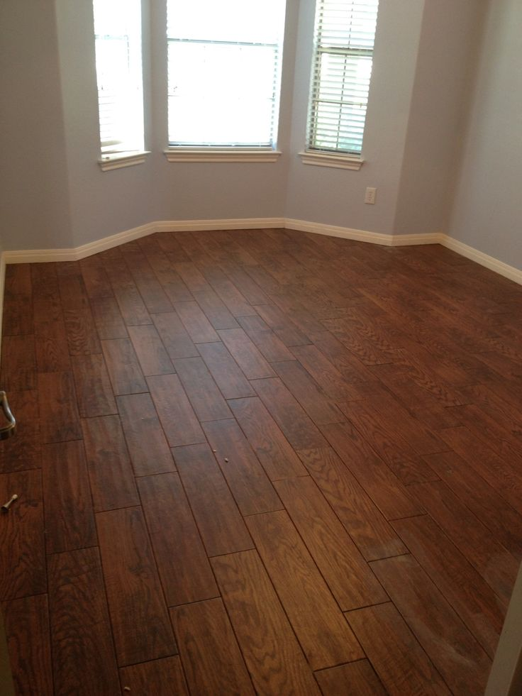 Tile that looks like wood love the durability floors for Hardwood tile flooring