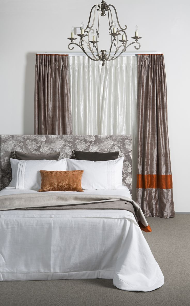 """""""Luxury Silk"""" curtains teamed with a headboard made up in """"Barnsbury"""".  The finishing touch is the lovely bedspread made up in """"Sabi"""".    www.lahood.co.nz"""