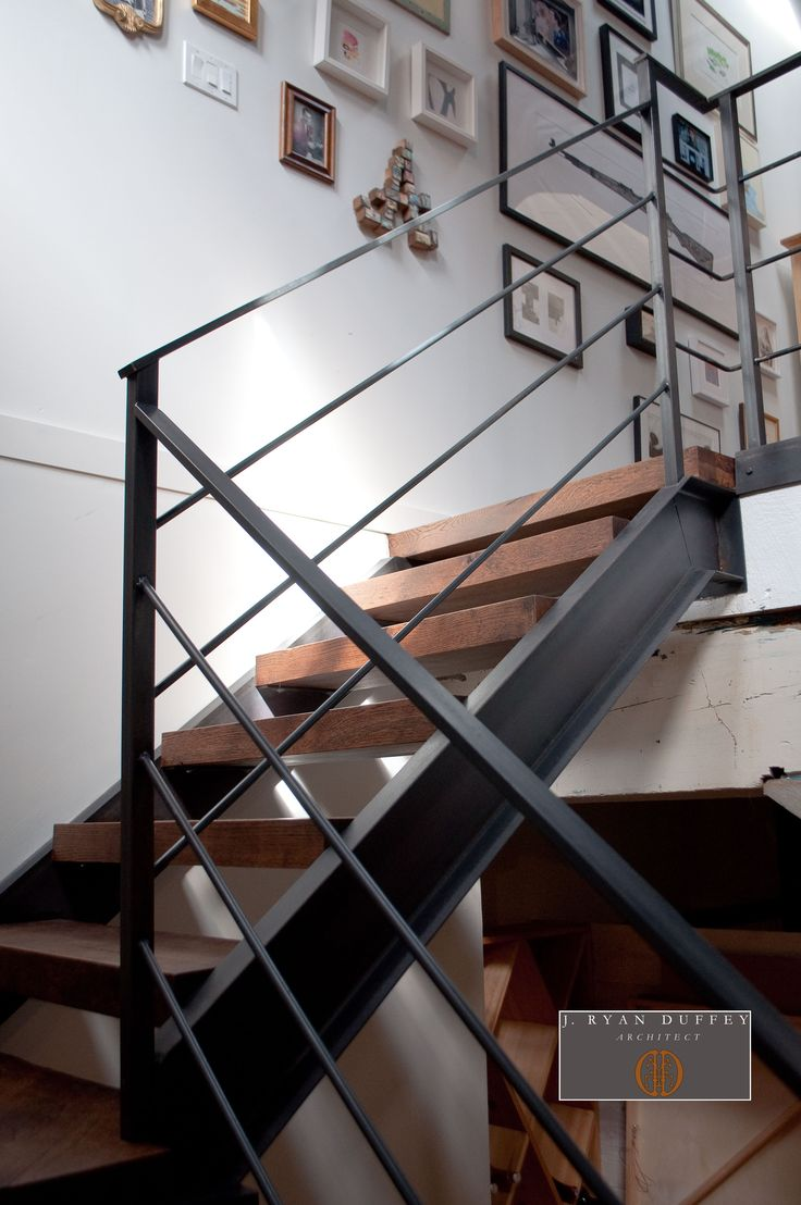 Industrial Loft Stair Hall - Architect Ryan Duffey removed the existing  narrow spiral staircase and created