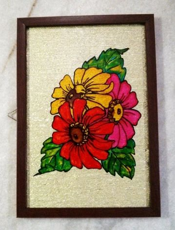 Gerbera Flower Glass Paint:The Three gerbera flowers are different colored and well bloomed in the morning sunshine.  Item Details:Material Used:  Glass Paint  Orientation: PortraitBackground: Light Golden Creep mould Frame Color: MaroonSize: A4
