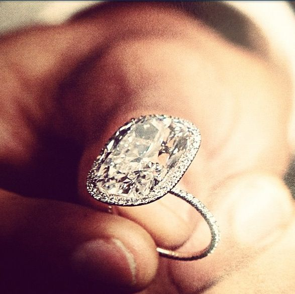 Probably my dream ring.... A Debeers Cushion cut solitaire surrounded by micropave diamonds and a micropave band. Breathtaking