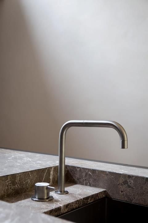 stone benchtop. recessed basin sink. mixer. minimal detail. Inset stainless steel sink and sink mixer tap. Vola.