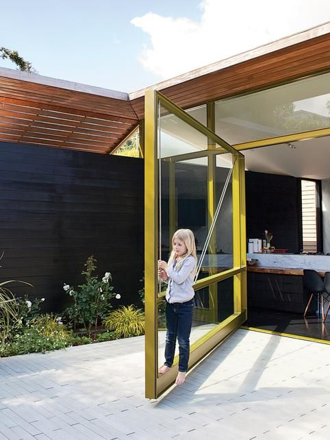 Architect Visit: Pivot Door Roundup : Remodelista-Love this mustard colored one!