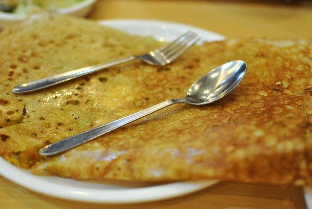 Dosa is made from black lentils and rice and is a lot like eating a crêpe. It is very common in Southern India and is a favorite breakfast item. You can get them filled with a variety of fillings such as paneer cheese, potatoes, tomatoes, and onions.