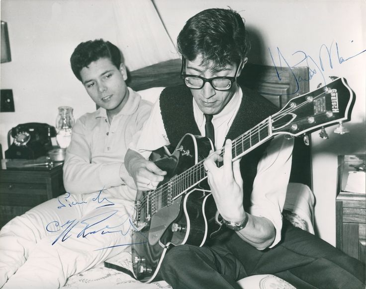 RICHARD CLIFF: (1940-     ) British Pop Singer. Vintage signed 9.5 x 7.5 photograph, an early image of the singer in a head and shoulders pose alongside an unidentified, older gentleman. Signed ('Sincerely, Cliff Richard') in bold blue fountain pen ink to a clear area of the image.
